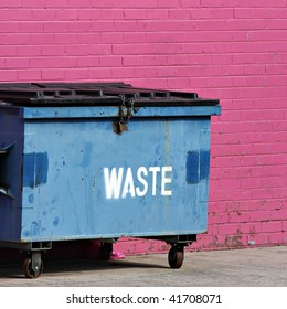 Blue dumpster against a bright pink wall