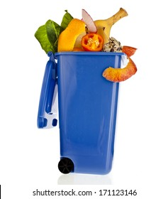 Blue Dumpster filled household waste kitchen scraps  isolated on white background