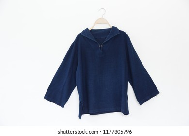 Blue dye blouse is clothes hanger on white background.