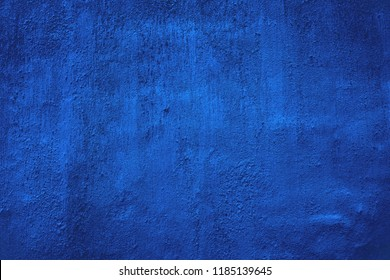 Blue dyed wall texture  background. Plastered  and dyed wall surface.