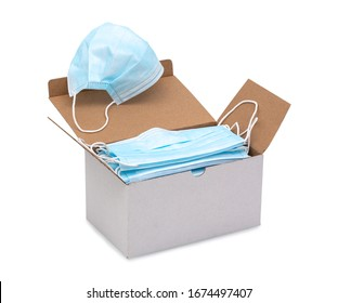 Blue ear loop surgical face masks in a box isolated on white background with clipping (vector) path. Disposable procedural face mask with malleable nose clip. Protective mask with elastic ear bands.