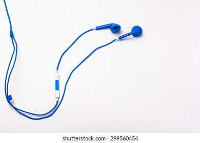 Blue earphones isolated on white background