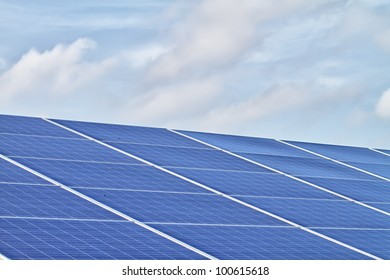 blue ecological solar cells and cloudy sky background