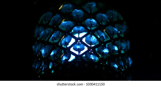 Blue electric light bulb with cover isolated object photograph