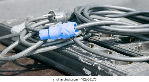 the blue electric plug on black cable