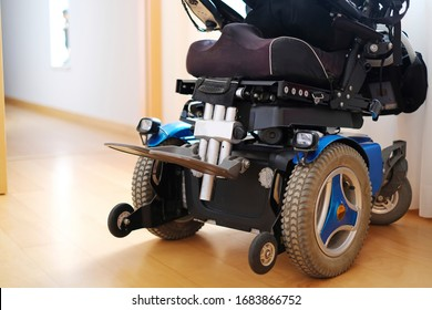 Blue electric wheelchair for disabled people - indoors