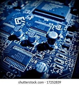 Blue electronic circuit close-up. Macro background 2
