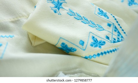 blue embroidery on white kitchen towel