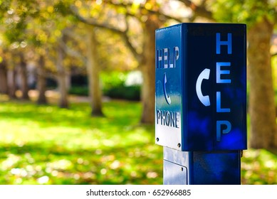 "A blue emergency phone box labeled ""HELP"" at a university campus in Melbourne, Australia."