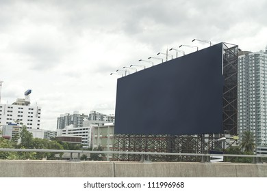 blue empty billboard on city.