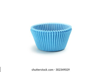 Blue empty cupcake cases isolated on white