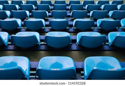 Blue empty plastic seats background