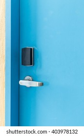 Blue entrance door with electronic keycard lock system