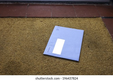 Blue envelope from the Dutch tax office on the door mat