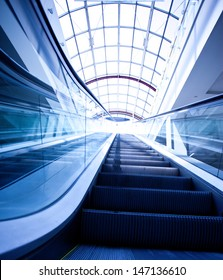 blue escalator in modern building