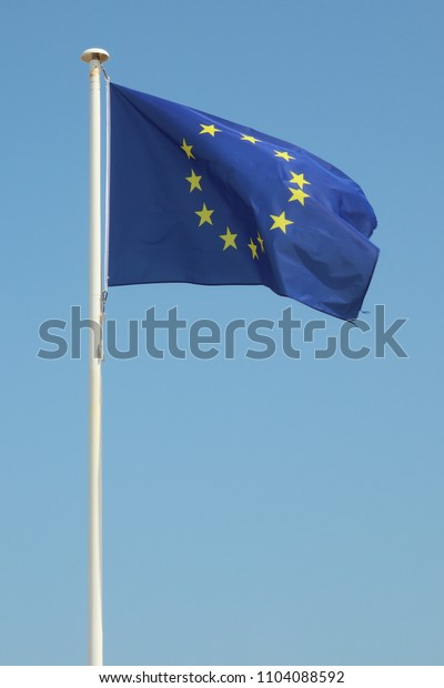 Blue europe european flag floats in the wind
