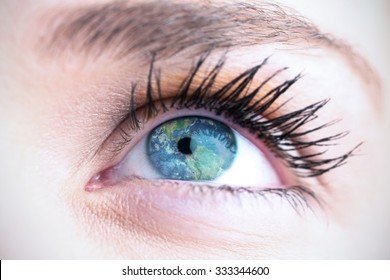 Blue eye against earth
