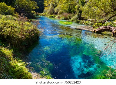 The Blue Eye (Albanian: Syri i Kalter, is a water spring near Muzine in Vlore County, southern Albania. A popular tourist attraction. The water bubbles from a more than fifty meter deep pool.
