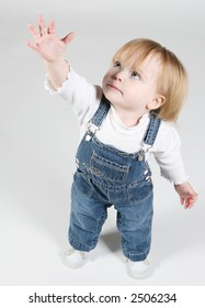 blue eye baby girl standing and reaching up
