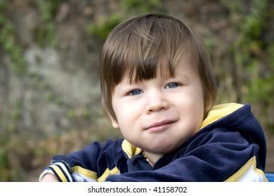 Blue eye baby in park