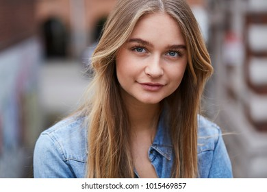 Blue eye girl in blue shirt, portrait