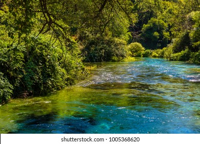 """Blue eye spring pot """"Syri i Kalter"""" - the water spring and natural phenomenon is a popular tourist attraction, Albania"""