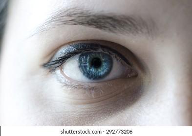 Blue eye woman macro shot