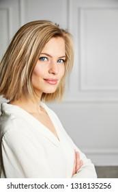 Blue eyed blond girl in white, portrait