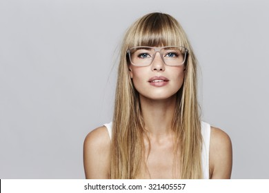 Blue eyed blond student in glasses, portrait