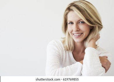 Blue eyed blond woman smiling to camera