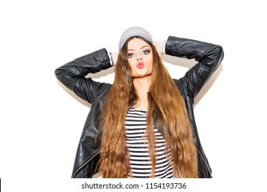 Blue eyed teenage girl posing, making kissy face, with hands on her head. Isolated on white, studio lighting, mild retouch.