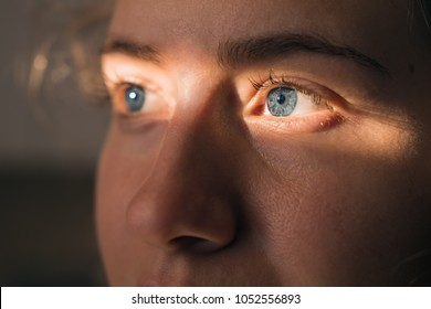 Blue eyed woman's face