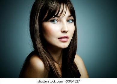 blue eyes brunette beauty portrait studio shot