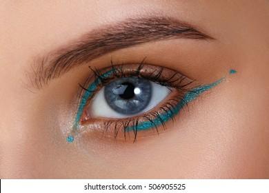 Blue eyes. Eye makeup. Beautiful eyes make-up. Holiday makeup detail. Long eyelashes. Close-up shot of female eye make-up