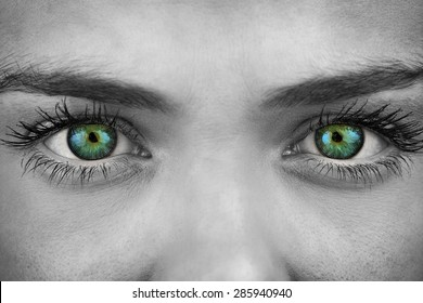 Blue eyes on grey face against spiral