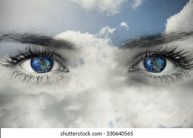 Blue eyes on grey face against blue sky with clouds