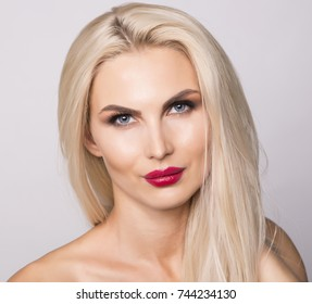 Blue eyes and red lips, portrait close up shot