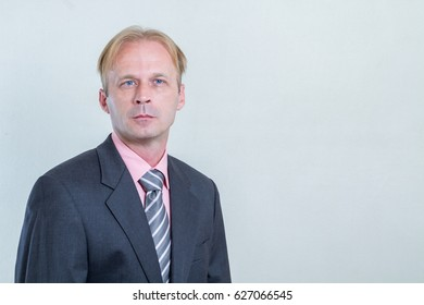 Blue eyes trustworthy middle aged man professional portrait isolated