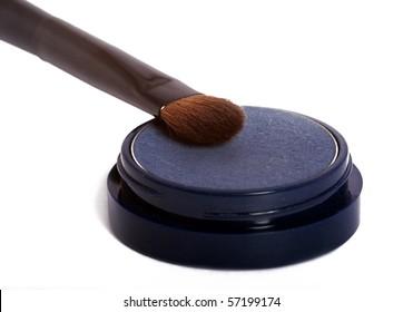 Blue eyeshadow and brush
