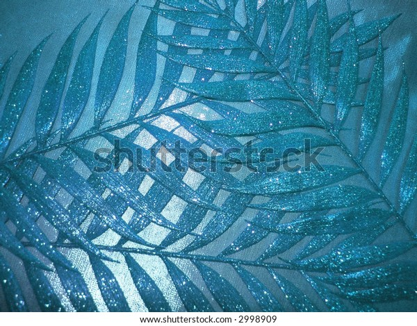 blue fabric texture and leaves for background