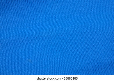 blue fabric of a work suit with texture