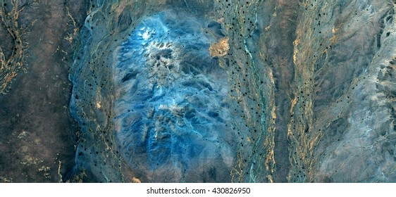 blue face, abstract photography of the deserts of Africa from the air, Science fiction,Photographs magic,artistic,landscapes of your mind, optical illusions, abstract art