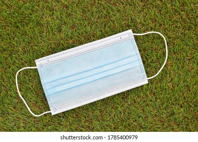 Blue Face mask outdoors on green grass