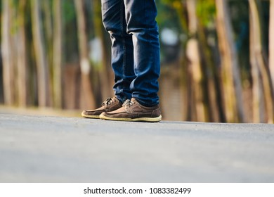 Blue fade jeans pant with leather shoes isolated unique fashionable dress stock photo