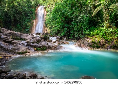 Blue falls of Costa Rica, natural landscape at Bajos del Toro close to the Catarata del Toro and San Jose. Photo taken at slow shutter speed and with ND filter. Smooth waterfall.