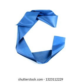 Blue fashion ribbon on white background. Letter C from blue silk strip. Alphabet.