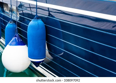 blue fenders on a boat