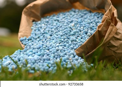 Blue fertilizer in brown paper bag