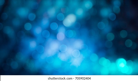Blue Festive Christmas Beautiful abstract Background with bokeh lights. Holiday Texture with copy space. Can be used as Wallpaper, filling for a website, defocused