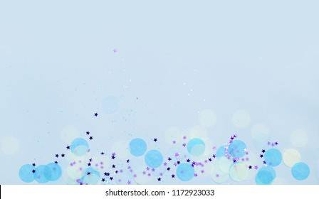 Blue festive confetti, glitter and stars. New year and christmas background. Copy space for text. Holiday banner